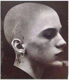 Shaved, pierced, scare &tattooed girl Unknown date&photographer via @she_comes_in_technicolor  https://www.instagram.com/p/BH55mi2B3Ax/