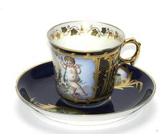Sevres Demitasse Cup and Saucer with putti and gilt trim