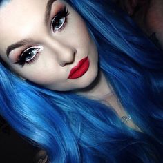 We're so excited that the #beautiful and talented #mua @alyssamarieartistry just used our #badboyblue, #bluemoon, and #pastelizer to get her cornflower #bluehair! The #color looks especially #lovely paired with a complementary #redlip. For the #perfect shade, get our #lethallipstick in #CSRed .
