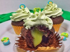 Guinness Stout chocolate cupcakes. Lime curd filling. Lucky Charms whipped cream. St. Patrick's Day dessert!