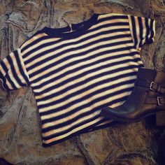 Stripped Crop Knit Sweater Super cute cropped sweater. Black and cream stripes. Silver zipper in the back. Medium weight. Never been worn! Excellent condition no snags! Tops