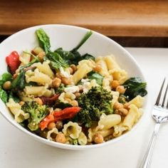 Roasted vegetable Mediterranean pasta salad, with roasted broccoli, red peppers, spiced chickpeas, and feta