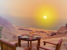 Dinner table setting overlooking Zighy Bay.