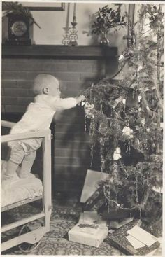 Baby helps decorate the tree