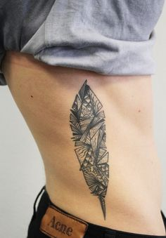 Partitioned Feather Tattoo - https://www.tattooideas1.org/placement/rib/partitioned-feather-tattoo/