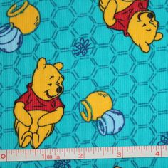 Corduroy Fabric Multi Color Tossed Winnie the Pooh Honeypots on Turquoise…