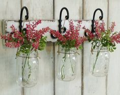 ***THIS IS FOR A SET OF 3 MASON JAR WALL DECOR....  ~~~~~Hydrangeas are now available and can with added to your order from pull down menu. They are a cream/white with green little centers.  The flowers have soft petite petals.....   These boards are  perfectly imperfect  with lots of rustic character. Some may have knot holes, cracks, holes etc.... No 2 are them same.  These are stained in a special custom stain color. Please note that no two boards will stain the same... Some may be…