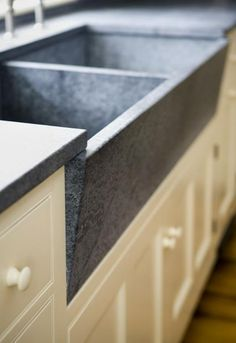 soapstone counter and double farmhouse sink. We can custom made to any size. Rustic Sinks