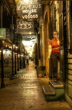 Marie Laveau's House of Vodoo, French Quarter New Orleans. An employee takes a smoke break in the doorway.