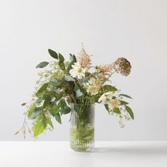 Lyngby Danish Vases | Unison | Think spring in all seasons with vases that compliment any bouquet without trying to steal the spotlight themselves. In 100% porcelain or glass, these sleek and clean showpieces put on a great solo performance.