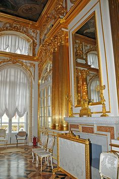 INTERIOR~ One of the State rooms in the Catherine Palace, Tsarskoye Selo, Russia. Very much in the Russian style, with white paneling, carved and heavily gilded.