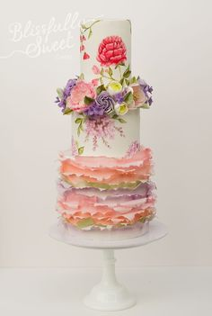 """Summer Wedding""~Pastel Florals Wedding Cake/Hand-painted flowers,wafer paper ruffles,halo of sugar flowers between top layers. The cake is lemon,coconut,raspberry & orange/almond cake by Blissfully Sweet"