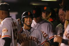 DENVER, CO - SEPTEMBER 2: Gregor Blanco #7 of the San Francisco Giants smiles in the dugout after scoring during the fifth inning against the Colorado Rockies at Coors Field on September 2, 2014 in Denver, Colorado. (Photo by Justin Edmonds/Getty Images)
