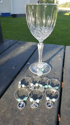 Items similar to 8 Wine glass markers, turquoise, yoga on Etsy Wine Glass Markers, Turquoise, Flute, Champagne, Yoga, Tableware, Etsy, Markers, Wine Glass