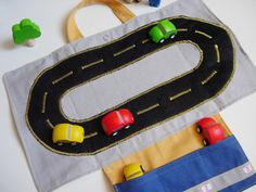 Car roll holder and little play mat for kids, travel toy. Ready to ship. €15,00, via Etsy.
