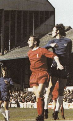 12th April 1971. Chelsea centre half John Dempsey out jumps Liverpool winger Peter Thompson, at Stamford Bridge.