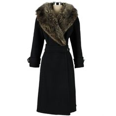 Vintage 1960's Black Wool Coyote Fur Collar Coat | From a collection of rare vintage coats and outerwear at http://www.1stdibs.com/fashion/clothing/coats-outerwear/