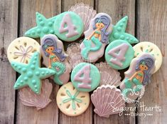 Purple And Aqua Mermaid Under The Sea Birthday Party Sugar Cookies TheIcedSugarCookie.com Sugared Hearts Bakery