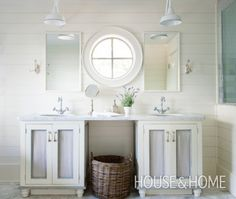 A porthole window adds a nautical touch. Symmetrical elements frame this porthole window that overlooks the lake in this refined Muskoka main bathroom. The cottage is dubbed Bellemere by homeowner Cory and Catherine Francisco, the owners of Muskoka Living Interiors.