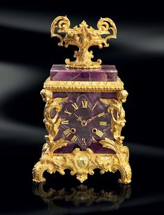 These clocks embody all the opulence and style of Baldi design. Elegant and decorative, they add a touch of personality to every luxury villas. Baldi Hernani figure clock in amethyst and gold plated bronze Antique Desk, Antique Clocks, Vintage Clocks, Purple Quartz, Purple Gold, Tabletop Clocks, Clock Table, Carriage Clocks, Design Apartment