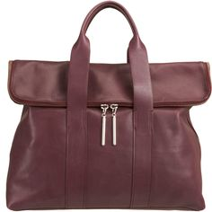 3.1 PHILLIP LIM Smooth leather zip top carry all with rolled top handles and signature foldover lip. Generous interior, meant to keep more items than there are hours in a day!