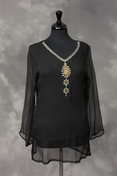 Black chiffon with gold embroidery, and white and turquoise stones.