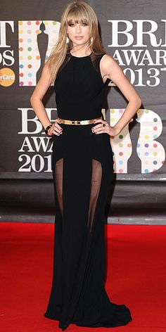 Wearing an Elie Saab gown, Giuseppe Zanotti heels, and Neil Lane jewels at the 2013 Brit Awards in London, England, February 20, 2013 wow this is the best she has ever looked. Young lady