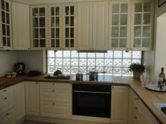 kitchen remodel with Ikea--this is exactly what I want! White/glass/wood!!!