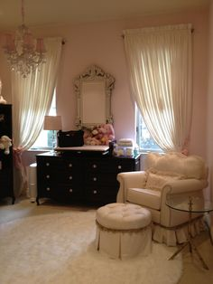 Carly dresser and slide top in Espresso, angel song chair and I lite 4 u chandelier= a beautiful nursery!!!!
