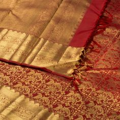 "The ""#Maroon"" #handwoven #Kanjivaram #Silk #Sari from Kanakavalli is woven with gold zari floral motifs all over the body that is set off by a gold zari border with horse motifs on either side. An attractive horses and floral motifs in gold zari adorn the maroon pallu. The border is repeated on the maroon blouse that completes the sari."