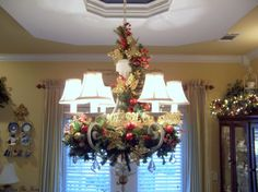 """Christmas Chandelier - garland in and around the chandelier and then hang crystals or ornaments from the garland.  Layer them, some """"outside"""" and some """"inside""""."""