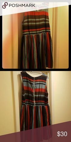 Fun Boutique Dress Flirty dress that transitions spring to summer to fall. Teal, burnt orange, navy and brown stripes with elastic waist and pleated skirt. Gold statement zipper on back. Pair with sandals in summer or a cardigan, tights and ankle boots in fall. Hem ends mid-thigh to knees. Like new! Size 2XL, but fits XL well. More well endowed ladies will find the chest snug. Very flattering on hips! Perch by blu pepper Dresses