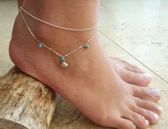 "Silver Anklet - Silver Ankle Bracelet - Foot Jewelry - Foot Bracelet - Chain Anklet - Summer Jewelry - Beach Jewelry. A fashionable and unique sterling silver anklet with 3 turquoise beads and one shell pendant. Water resistance. Just beautiful and delicate. Length of the bracelet: 17.7"" \ 45 cm + 2"" \ 5 cm extension. Item will arrive in a pretty gift box as shown in last image, ready to give, with my brand logo. --.--.--.--.--.--.Shipping --.--.--.--.--.--.-- I ship worldwide from…"