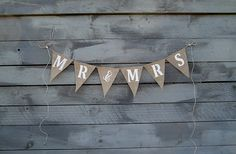 ~~Mr&Mrs~~ This banner would be great to celebrate your new married status. Made of natural burlap with white glittered letters. Comes with extra jute twine for tying. Burlap Bunting, Wedding Hire, Mr Mrs, Wedding Anniversary Gifts, Celebrity Weddings, Arrow Necklace, Etsy, Unique Jewelry, Handmade Gifts