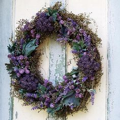 Fragrant Foliage This wreath combines dried sweet Annie, dried lavender, purple statice, globe amaranth, and large green kale leaves for a decoration that smells as good as it looks. Purple Wreath, Lavender Wreath, Floral Wreath, Dried Flower Wreaths, Dried Flowers, Fall Flowers, Purple Flowers, Globe Amaranth, Corona Floral