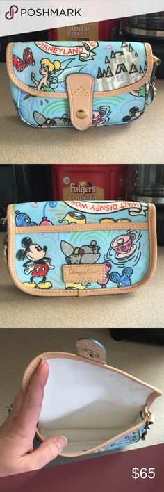 Disney Dooney and Bourke wristlet Like new, no flaws. Great placement! It does have the wrist strap too. Bags Clutches & Wristlets