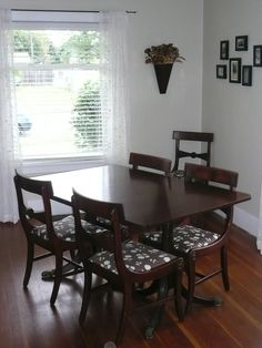 Refinished dining room table with reupholstered chairs.