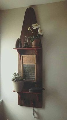wooden ironing board made into primitive shelf. Great idea.