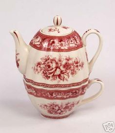 Red toile flower teapot and cup for one.  Believe this is a New teapot......
