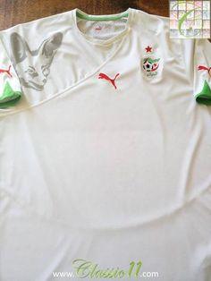 Relive Algeria's 2010/2011 international season with this original Puma home football shirt.