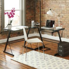 The L-shape provides the perfect corner wedge for space-saving needs and features a sliding keyboard tray and CPU stand. It's flexible configuration allows you to mount the trey on either side.
