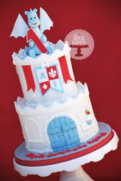 Castle Cake with Dragon - A little castle cake for a baby boy. Cake based on a castle cake by Yummy Cupcakes and Cakes. Dragon make from a tutorial by Spatula sisterhood.