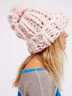Bobbi Chunky Pom Beanie   The chunkiest knit beanie to keep you warm all season long. Features a so-cozy knit design with a large, dramatic pom accent on top. Cuff it for a cool, effortless fit.