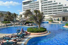 Get some sun poolside at JW Marriott Cancun Resort & Spa