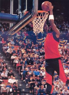 Michael Jordan's iconic black and red team colors make this warm-up suit memorable for all sports-style history.