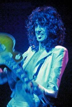 http://custard-pie.com/ 1977 Jimmy Page with a pick in his mouth! :)