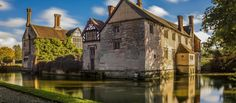 View of Baddesley from the moat on a bright autumn day