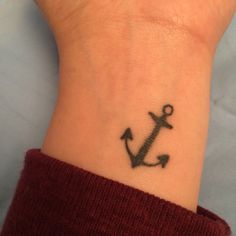 simple anchor tattoo on wrist.  hebrews 6:19 - we have this hope as an anchor for the soul, firm and secure.
