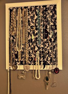 Necklace Hanger...take an old frame, metal lattice, fabric and hang your favorite necklaces! Better than them being all tangled in a box!