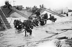 6 June 1944: Royal Marine Commandos of Headquarters, 4th Special Service Brigade, make their way from LCI(S) (Landing Craft Infantry Small) onto 'Nan Red' Beach at Saint-Aubin-sur-Mer. 6 May 2014: A view of the sea in the Juno beach area today. Photographs by Lt Handford/IWM/Getty and Peter Macdiarmid/Gett